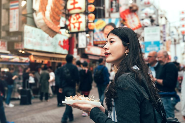 woman eating takoyaki