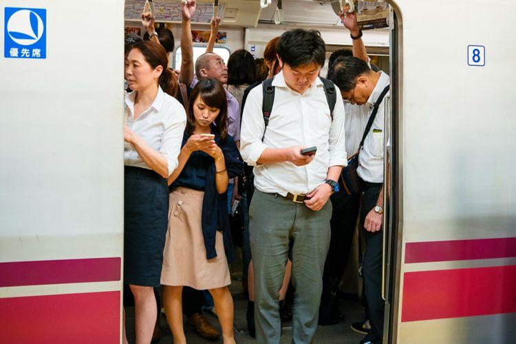 passengers by a train door