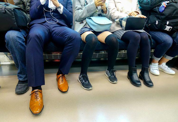 passengers' shoes aboard a train