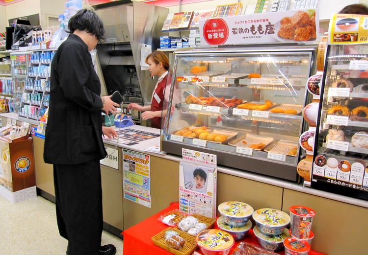 waiting at Japanese convenience store counter