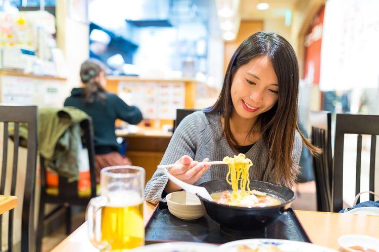 woman enjoying ramen