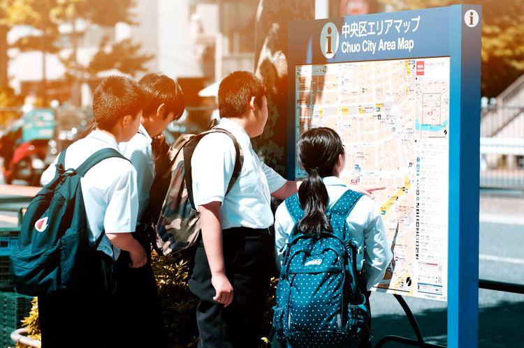 japanese students looking at map