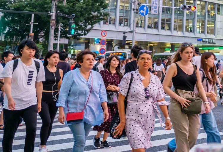 foreign tourists at shibuya scramble