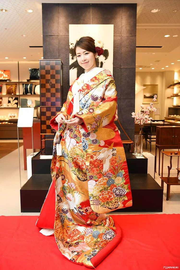 woman wearing a red and gold kimono