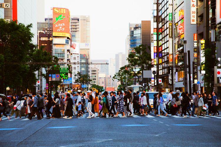 people crossing busy tokyo street