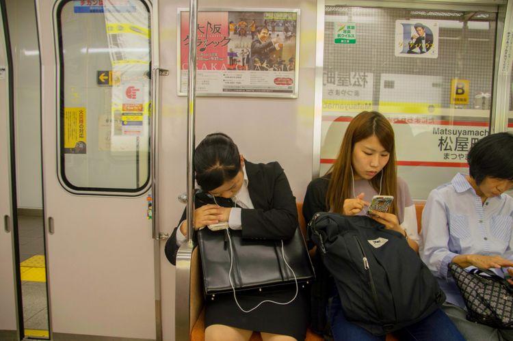 sleeping on Tokyo subway
