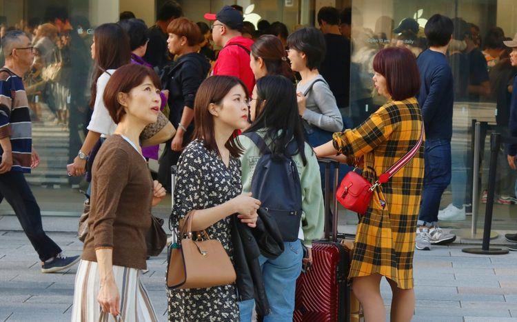 Japanese women walking down the street