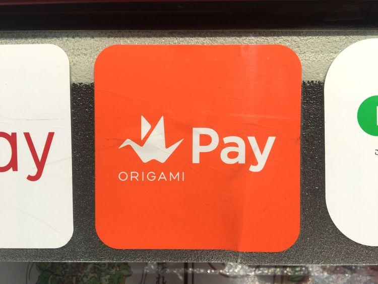 origami pay的橘色logo