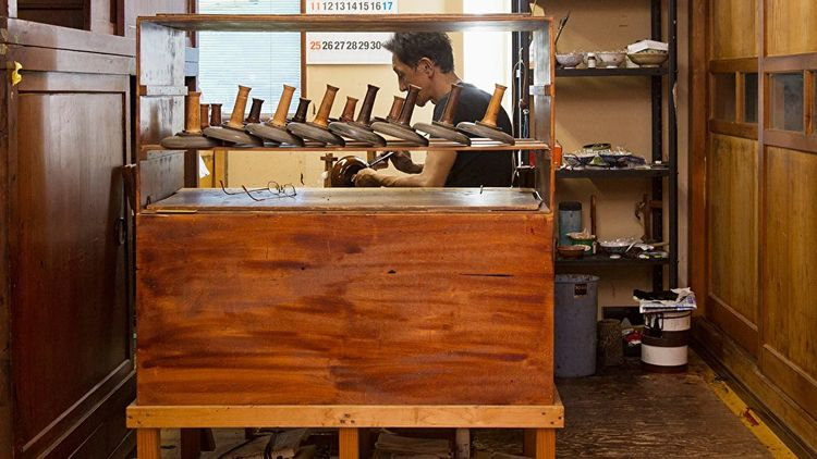 man working on lacquerware