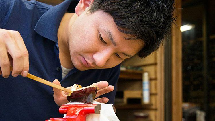 close up of man working on wajima-nuri