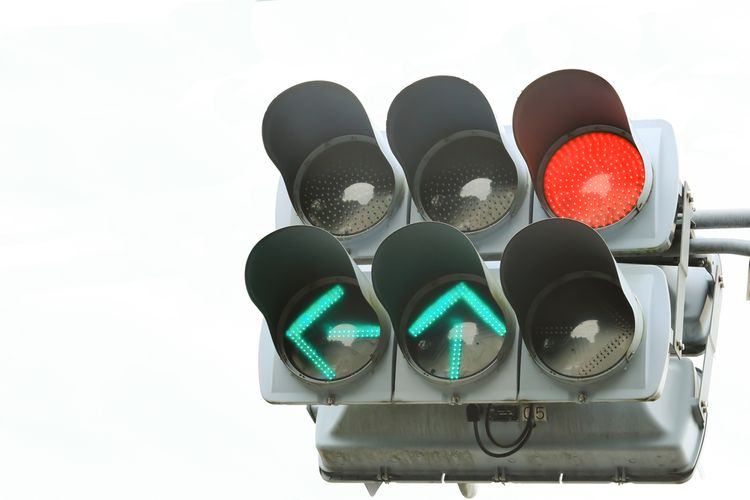Red light and green arrows