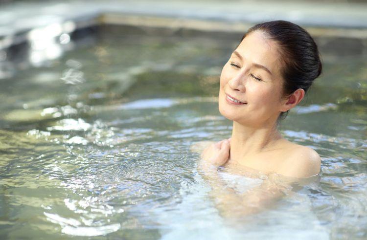 woman in sento relaxing