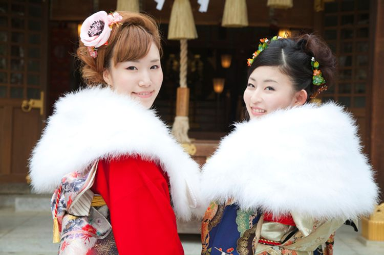 Two Japanese women wearing kimono new years hatsumode at a shrine